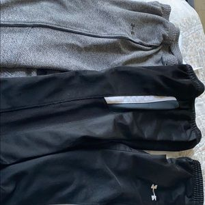 2 under Armour pants and 1 black